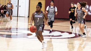 Arianna Jones brings the ball up the court during a 2018-19 Augsburg women's basketball game.